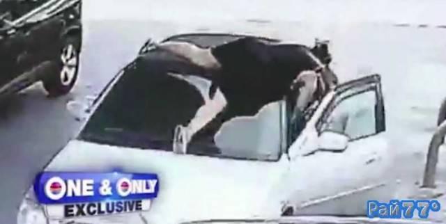 Американка, догоняя грабителя запрыгнула на крышу его автомобиля