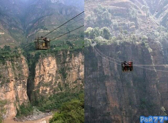 Жители удалённой китайской деревни добираются до «цивилизации» в железной клетке на 260-метровой высоте, над ущельем.