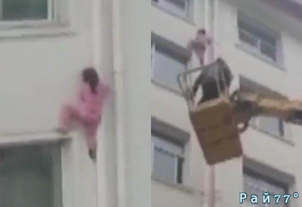 Китайский электрик спас девочку, вылезшую из окна квартиры на шестом этаже. (Видео)