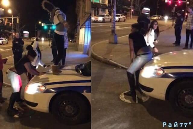 Полицейские разрешили девушкам исполнить эротический танец на капоте своего автомобиля. (Видео)